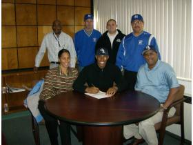 LHS Senior Vic Roache Jr. signs his letter of intent with Georgia Southern, with Athletic Director Sid Wright, Assistant Coach Al Robbins, Head Coaches Carlos and Marty Lozano, and parents Sabrina and Vic Roache Sr. Tuesday.