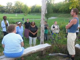 Participants in the Tour de Fresh explore and learn about the Frog Island Community Garden Tuesday night. The tour is put on annually by local non-profit Growing Hope.