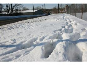 Snow removal enforcement was encouraged by City Council after repeated complaints some property owners do not shovel. The old Motor Wheel facility, above, was on that list of repeat offenders.