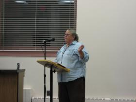 Ypsilanti resident and local hobbyist bee-keeper Lisa Bashert addresses City Council Tuesday during their deliberation on keeping bees in the city. The matter was postponed pending changes in the language.