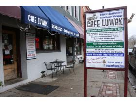 Cafe Luwak will remain open for at least another year while owner Jim Karnopp looks for a business partner to run the restaurant.