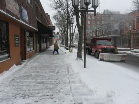The sidewalk in front of Pub 13 downtown is cleared as snowfall continues in the winter storm today. Throughout today and tonight, 5 to 9 inches is expected to accumulate before 10 a.m. Wednesday.