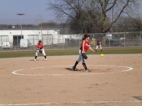 Willow Run junior starting pitcher Katie Mullins in the third inning in the team's home-opener against Huron Valley Lutheran High School. Flyers lost 13-4 against the Hawks Tuesday.