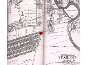 The 'House of All Nations' stood on a now-vanished stretch of Monroe between Huron and Hamilton streets. The red dot, placed by author Laura Bien, shows its location on this map.