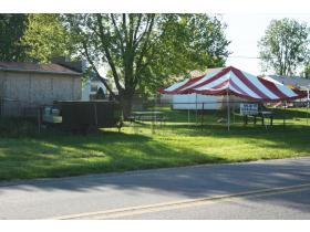 The property being used as a barbecue manufacturing and retail operation along Ford Boulevard just south of Clark Road in Ypsilanti Township is actually owned by the township, which will take the adjacent resident to court over the matter.