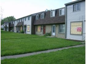 Many of the homes in the Liberty Square complex on Grove Street in Ypsilanti Township are already boarded and ready for foreclosure sale. All 151 units, some of which are still occupied, will be condemned Tuesday, Ypsilanti Township has resolved.