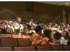 Connie Shelton, an East Middle School Teacher, speaks against the WISD transportation consolidation plan at Monday's special meeting of the Ypsilanti Board of Education. The board approved the motion to join the consolidation by a vote of 5 to 2.