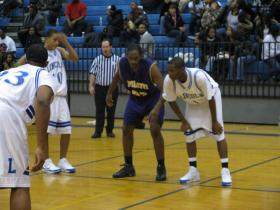 Ypsilanti's Brandon Morris (center) led the Phoenix with 20 points, in a 65-40 victory against Lincoln.
