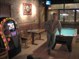 Tap Room owner Brian Brickley stands in the new addition to his bar, a two-year project set to open as a game area Monday.
