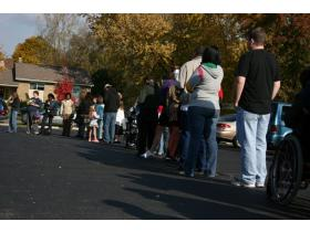 Voters wait in line to cast their ballot.