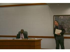Lt. Jim Anuszkiewicz, right, answers questions from the Superior Township Board of Trustees at Monday evening's meeting.
