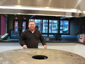 David Curtis poses at the Mongolian-style grill in Ypsilanti's soon-to-be newest restaurant. J. Neil's Mongolian Grill is expected to open within the next month.